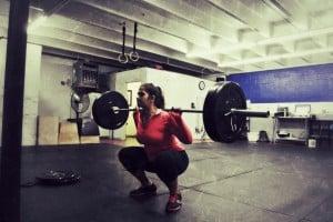 Lauren squatting something heavy