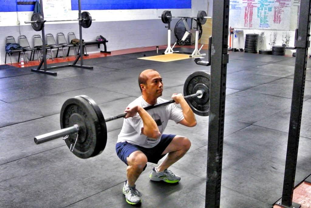 Rex front squatting